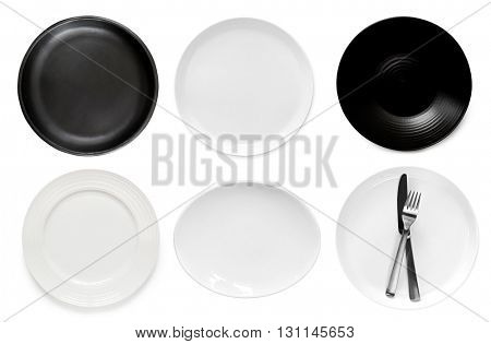 Collection of empty plates, top view, isolated on white.