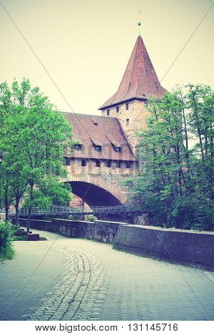 Old tower and bridge in Nuremberg, Germany. Instagram style filtered image