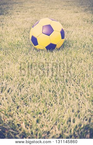 Retro Toned Picture Of A Soccer Ball On Grass.