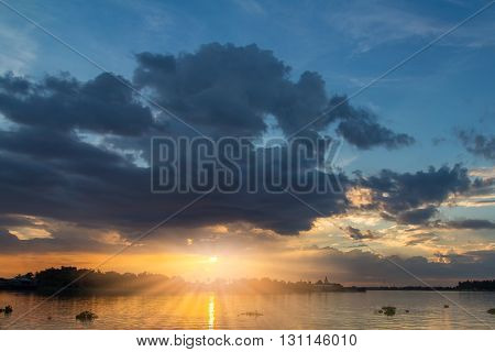 Sunset sky with sunray beside the river abstract for background