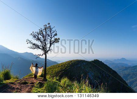 Elegant woman admiring landscape