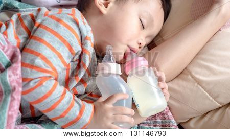 Asian Baby Boy Sleeping In Mother Arm