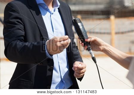 Journalist making media interview with businessman. Body language.