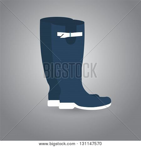 Rubber boots isolated on a grey background
