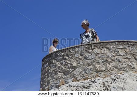 MAIORCA, SPAIN - MARCH 13: two women at the Cabo Formentor, on March 13, 2016 in Palma de Maiorca, Maiorca Island, Spain