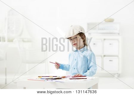 happy children paint indoors