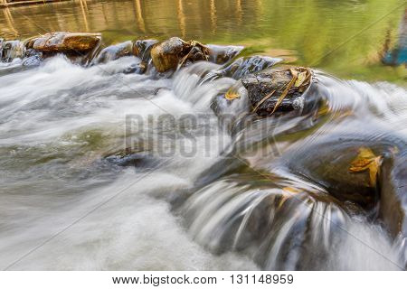 small weir irrigate in the canal with long exposure