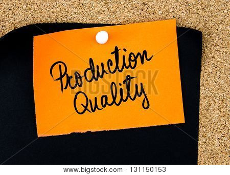Production Quality Written On Orange Paper Note