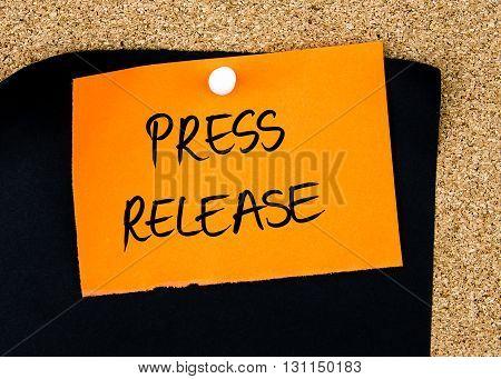 Press Release Written On Orange Paper Note