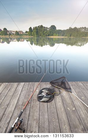 Fishing Equipment And Catch On A Wooden Pier