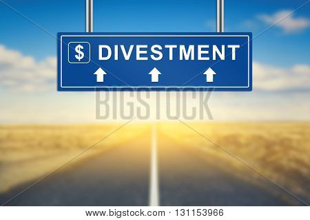 divestment words on blue road sign with blurred background