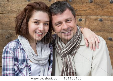 Pretty Couple Hugging In Urban Park Sitting In A Bench