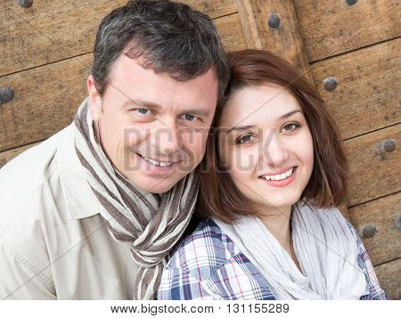 Lovely Couple Hugging In An Urban Park Sitting In A Bench