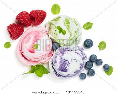 Top view of ice cream of berry (blueberry raspberry) and green leaves of mint isolated on a white background.