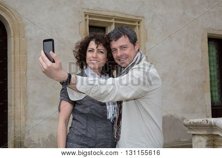 Couple Of Tourists Taking Selfie In Historical Area