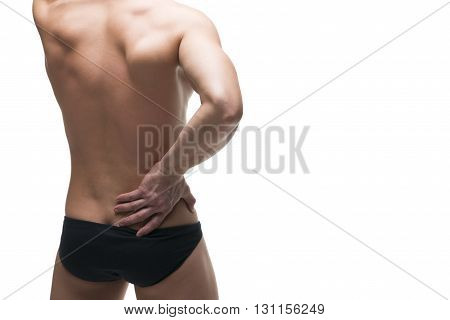 Kidney pain. Man with backache. Pain in the human body. Muscular male body. Isolated on white background. Middle part of the body