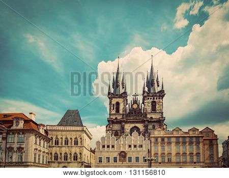 Old Town of Prague buildings, Czech Republic. View on Tyn Church and historic colorful tenement houses, blue sky. Vintage