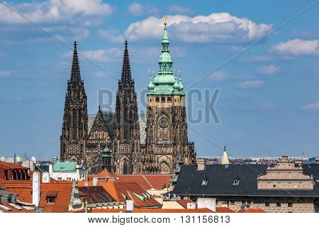 St. Vitus Cathedral, Prague, Czech Republic over old town red roofs