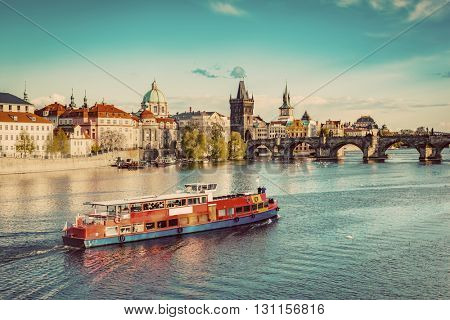 Prague, Czech Republic skyline with historic Charles Bridge. Boat cruise on Vltava river. Vintage