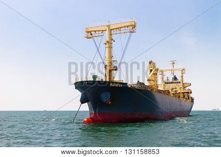 container ship float on the sea and blue sky background