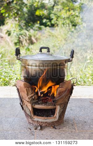 Old Aluminium Pot On Stove With Fire And Smoke, Folk Cooking Way