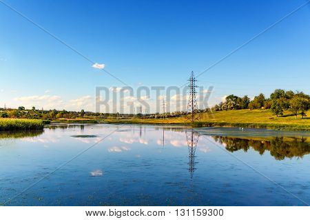 Landscape with blue sky and the reflection of the sky in the lake