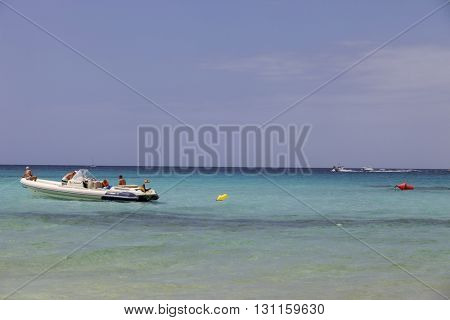 MAIORCA, SPAIN - MARCH 13: people in a boat at the beach, on March 13, 2016 in Palma de Maiorca, Maiorca Island, Spain