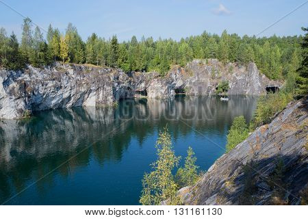 Canyon and lake in situ mining of marble mines. Ruskeala, Karelia, Russia