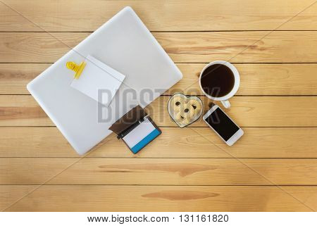 Top View Blank Paper Note On Notebook Of Laptop With Things, White Cup Of Black Coffee ,pen,empty Bu