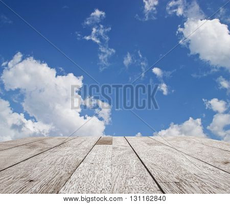 Wooden table top on blue sky with cloud for design, can be use for display or montage you product