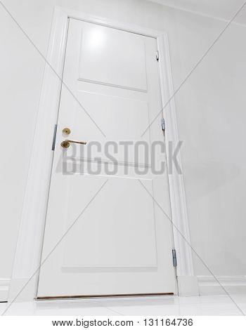 Closed White Domestic Door. Empty Interior