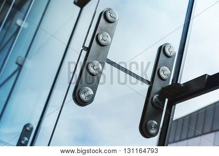 Metal Fixing With Bolts For Glass Windows