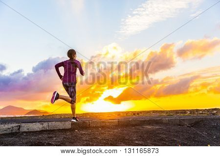 Athlete trail running silhouette of a female runner on sunset road sunrise. Cardio fitness woman training for marathon race. Active healthy lifestyle in summer nature outdoors. Life challenge concept.