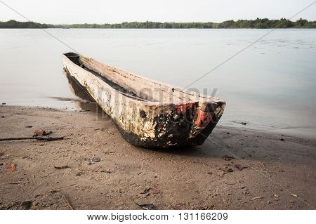 Traditional dugout wooden canoe on the Mono's river shore Benin Africa 2015
