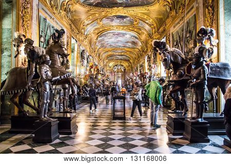TURIN ITALY - APRIL 25 2016 - Visitors at the Royal Armoury of Turin one of the world's most important collections of arms and armour located in the Royal Palace.