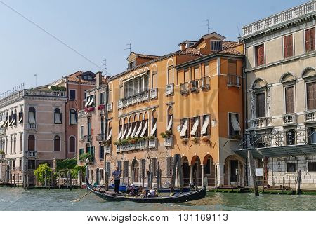 Venice, Italy- August 26, 2010: Gondolas and beautiful classical buildings on the Grand Canal Venice Italy