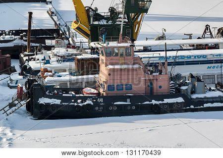 Tyumen, Russia - February 16. 2008: Industrial and pasenger ships on winter parking of river port