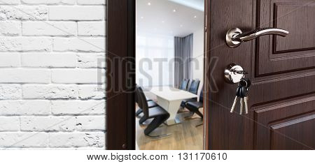 Half opened door to a cabinet or office. Door handle, door lock. Lounge door half open. Opening door. Privacy, welcome concept. Entrance to the room. Door at white brick wall, modern interior design.