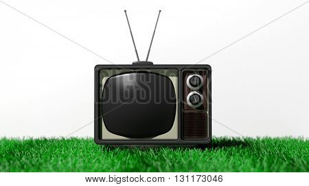 Antique TV set with black screen on grass, isolated on white background. 3D rendering