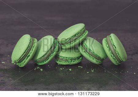 Jasmine Green Tea Macarons. Jasmine green tea macarons with powdered spirulina. Macro, selective focus, vintage toned image, blank space