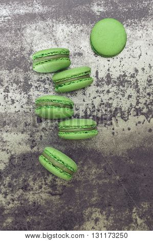 Spirulina green tea macarons on concrete background.  Top view, blank space