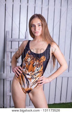 Tiger on girl's swimming suit , studio shot