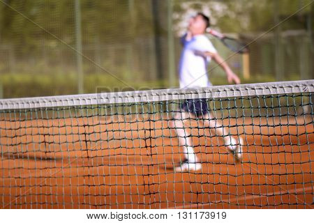 Tennis net Man plays tennis blurred motion