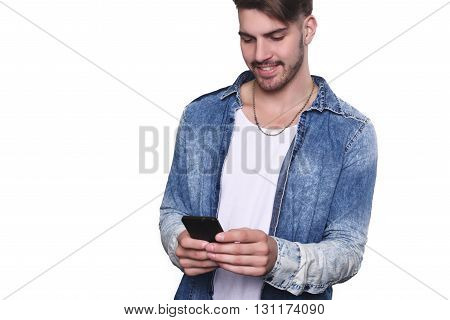 Close up of a young man typing on his smartphone. Isolated white background.