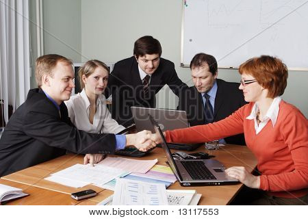 Group of business people working together in the office.