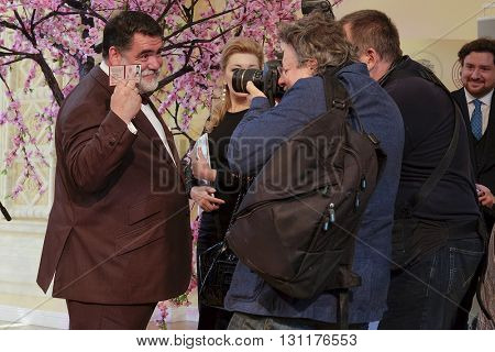 Moscow, Russia - May, 23, 2016: the businessman Mikhail Kusnirovich, the sponsor of La Scala theater Moscow tours, communicates with journalists at a press conference in Moscow devoted to this tours.