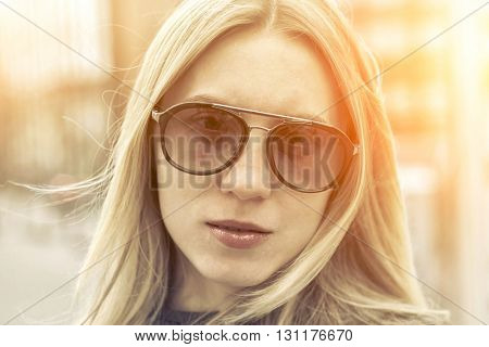 Portrait of blonde female on the street.