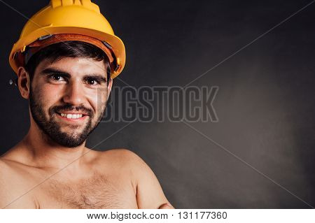 Portrait of a happy bearded worker - isolated on black.
