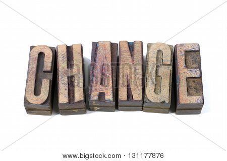 change word made from scattered wooden letterpress type isolated on white