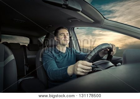 Man sitting and driving in the car.